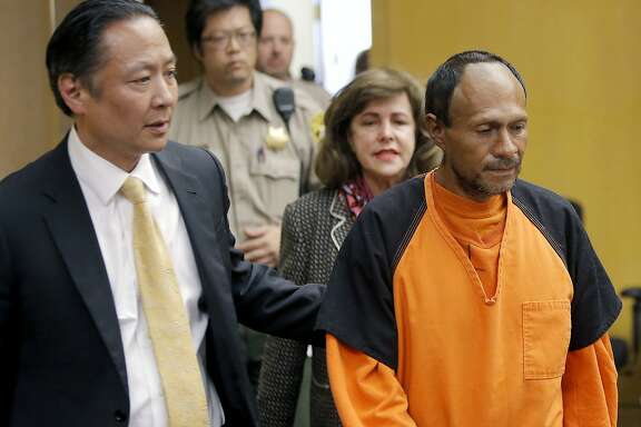 FILE - In this July 7, 2015 file photo, Jose Ines Garcia Zarate, right, is led into the courtroom by San Francisco Public Defender Jeff Adachi, left, for his arraignment at the Hall of Justice in San Francisco. The bullet that killed Kate Steinle two years ago ricocheted off the ground about 100 yards away before hitting her in the back and later launching a criminal case at the center of a national immigration debate. A San Francisco police officer who helped supervise the investigation testified about the bullet's trajectory Monday, Oct. 30, 2017 at Zarate's trial. (Michael Macor/San Francisco Chronicle via AP, Pool, File)