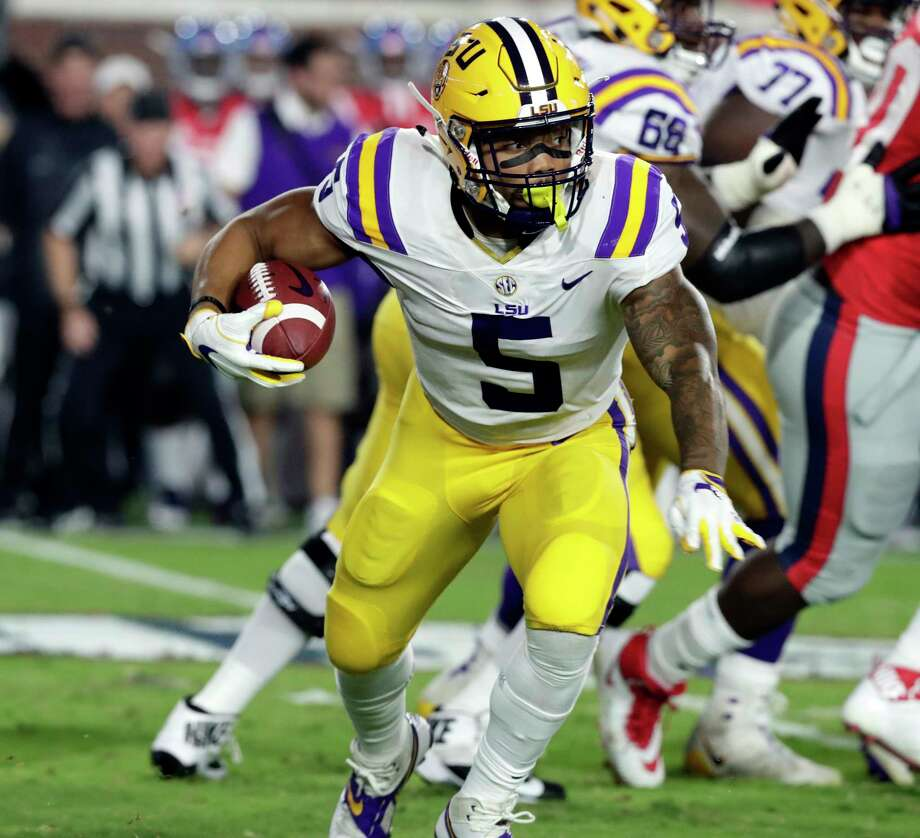 LSU running back Derrius Guice (5) runs for a first down past Mississippi defenders in the first half of an NCAA college football game in Oxford, Miss., Saturday, Oct. 21, 2017. (AP Photo/Rogelio V. Solis) Photo: Rogelio V. Solis, STF / Copyright 2017 The Associated Press. All rights reserved.