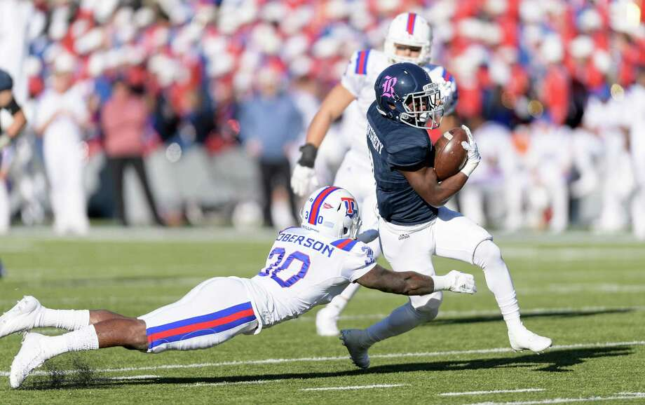 Cameron Montgomery (8) of the Rice Owls is brought down by Aaron Roberson (30) of the Louisiana Tech Bulldogs after a reception in the second half in a Conference USA football game on Saturday, October 28, 2017 at Rice Stadium in Houston Texas. Photo: Wilf Thorne / © 2017 Houston Chronicle