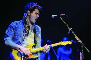 John Mayer performs during a concert at Cynthia Woods Mitchell Pavilion on July 12.