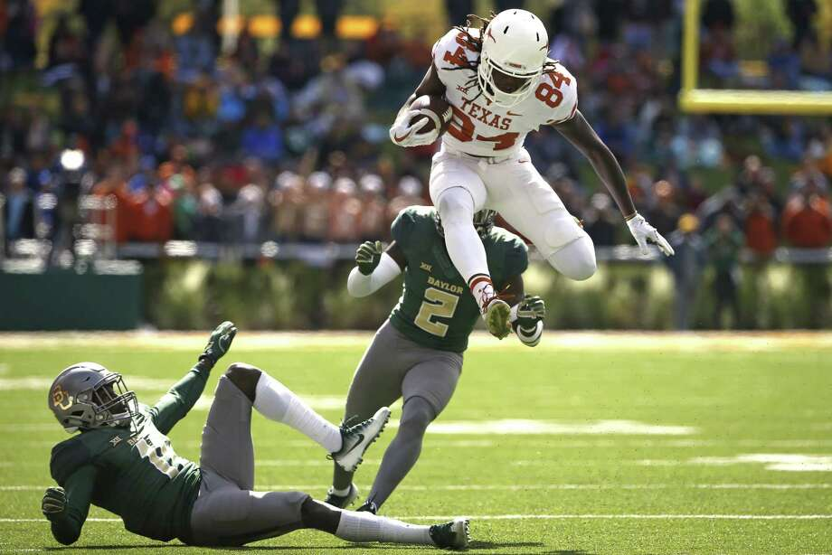 Lil'Jordan Humphrey #84 of the Texas Longhorns leaps past defenders Jameson Houston #11 and Taion Sells #2 of the Baylor Bears in the second half at McLane Stadium on October 28, 2017 in Waco, Texas. Texas won 38-7. (Photo by Ron Jenkins/Getty Images) Photo: Ron Jenkins, Stringer / 2017 Getty Images