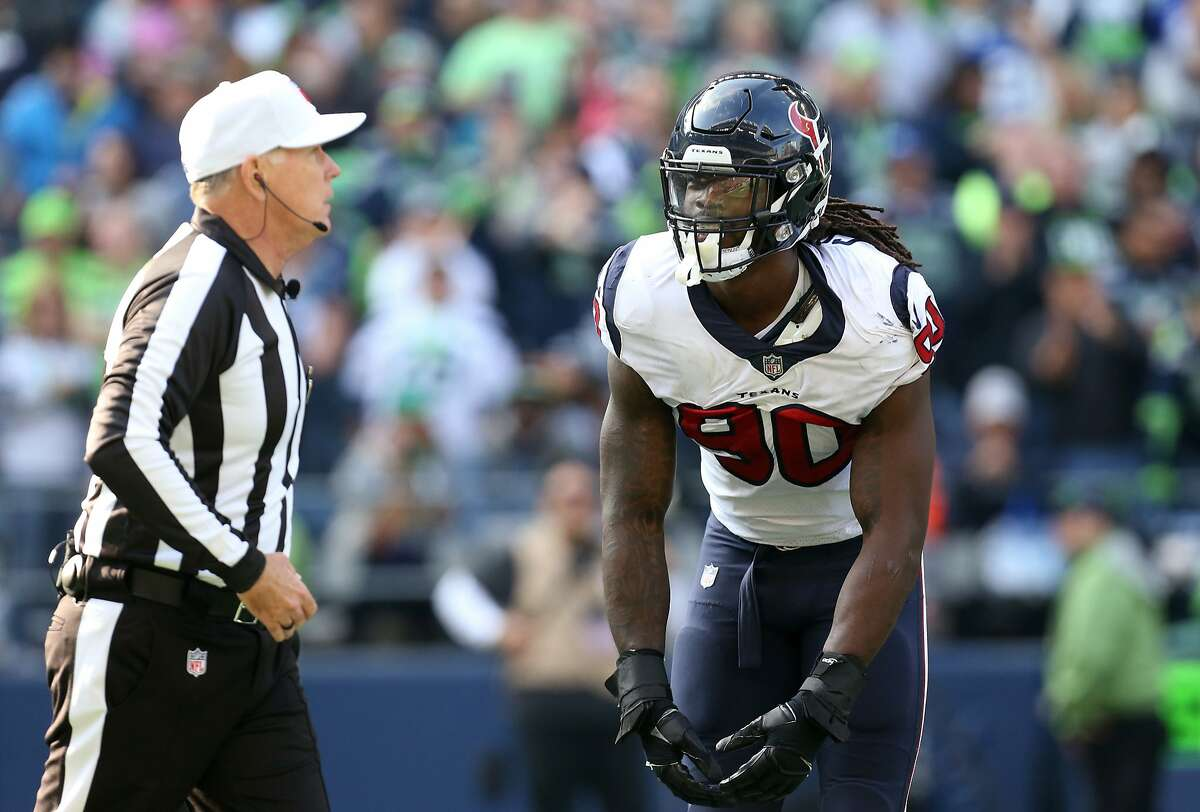 Houston Texans outside linebacker Jadeveon Clowney (90) disagrees with a penalty called against him during the first half of the game against the Seattle Seahawks at CenturyLink Field Sunday, Oct. 29, 2017, in Seattle. The Seahawks won 41-38. ( Godofredo A. Vasquez / Houston Chronicle )
