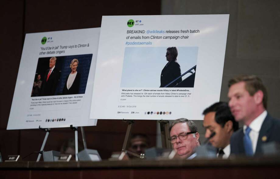 Rep. Eric Swalwell, D-Calif., right, with Reps. Joaquin Castro, D-Texas, center, and Denny Heck, D-Wash., questions Facebook's General Counsel Colin Stretch, Twitter's Acting General Counsel Sean Edgett, and Google's Senior Vice President and General Counsel Kent Walker, about the Russian ads during a House Intelligence Committee task force hearing on Capitol Hill in Washington, Wednesday, Nov. 1, 2017. (AP Photo/Manuel Balce Ceneta) Photo: Manuel Balce Ceneta, STF / Associated Press / Copyright 2017 The Associated Press. All rights reserved.