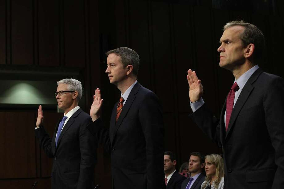 "(L-R) Vice President and General Counsel for Facebook Colin Stretch, General Counsel for Twitter Sean Edgett, and Senior Vice President and General Counsel for Google Kent Walker are sworn in during a hearing before the Senate (Select) Intelligence Committee November 1, 2017 on Capitol Hill in Washington, DC. The committee held a hearing on ""Social Media Influence in the 2016 U.S. Elections."" Photo: Alex Wong / / 2017 Getty Images"