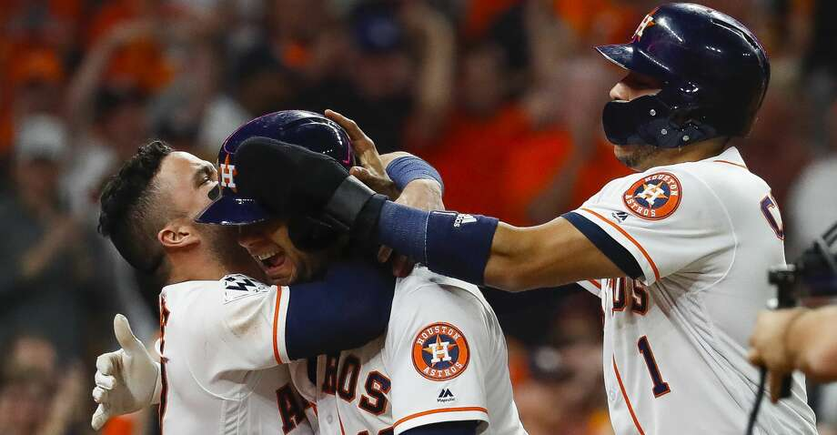 Houston Astros second baseman Jose Altuve (27), first baseman Yuli Gurriel (10) and shortstop Carlos Correa (1) celebrate Gurriel's three-run home run during the fourth inning of Game 5 of the World Series at Minute Maid Park on Sunday, Oct. 29, 2017, in Houston. ( Karen Warren  / Houston Chronicle ) Photo: Karen Warren/Houston Chronicle