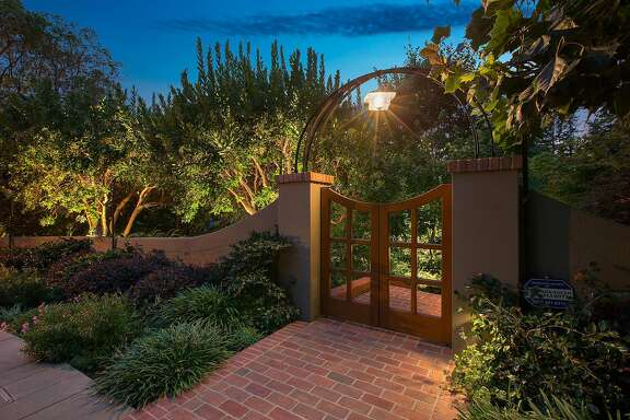 A pedestrian gate stands before the Piedmont home.