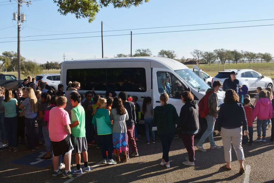 Plainview Christian Academy students get their first look at the school's brand new Ford Transit Passenger Wagon. The van was obtained with funds provided by students, teachers and parents to pay for the vehicle. Photo: William Carroll/Plainview Herald