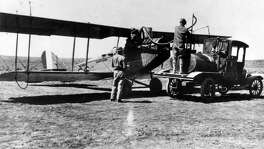 A Curtis JN-4D Jenny being fueled at Kelly.