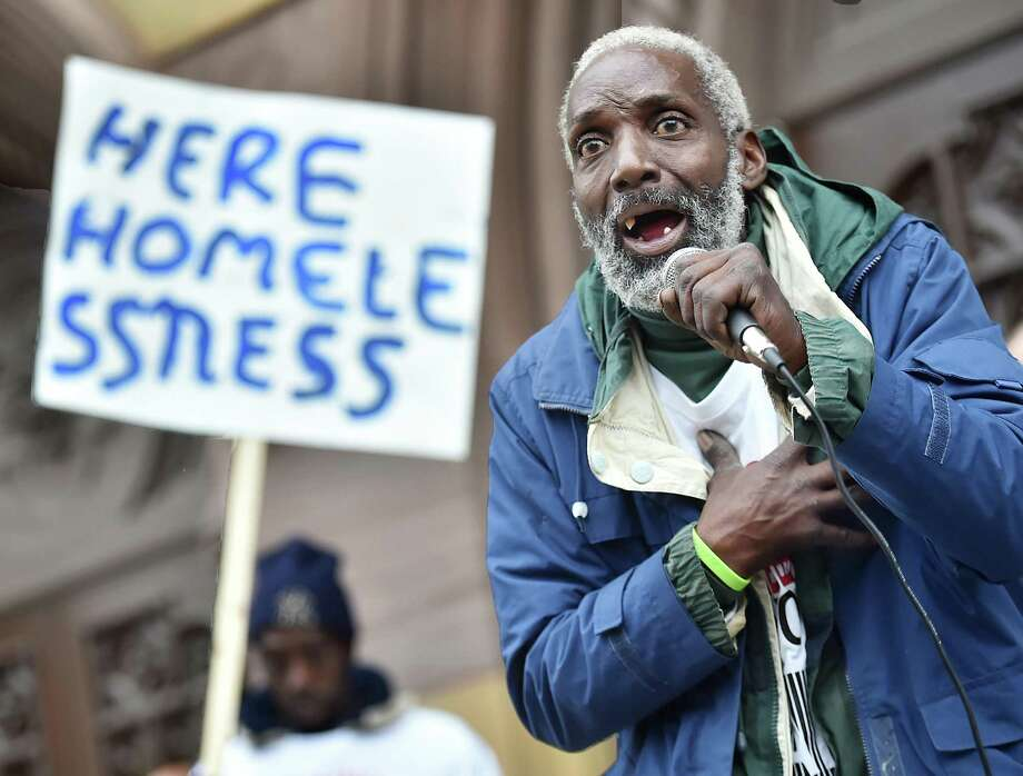 Bealton Dumas, who is homeless, speaks during a rally on the steps of New Haven City Hall in an effort to end alleged discrimination against the homeless sponsored by the Connecticut Bail Fund Wednesday. Photo: Catherine Avalone / Hearst Connecticut Media / New Haven Register