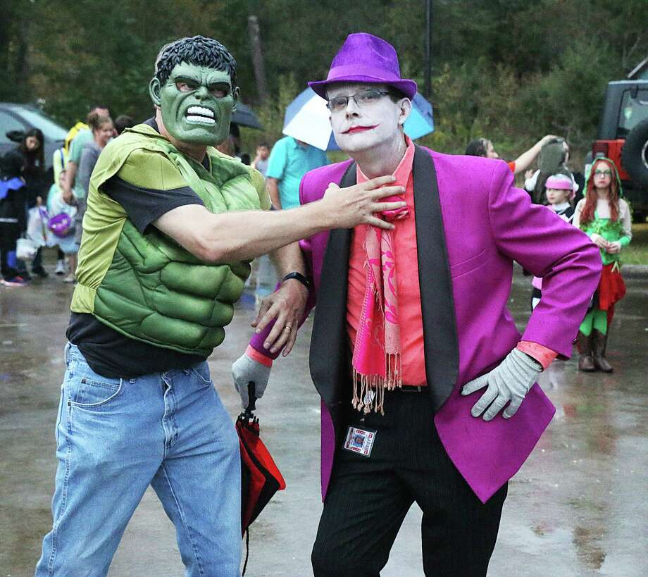 """The Incredible """"Husk,"""" otherwise known as Northside Elementary Principal Edward Husk, and The Joker, Pete Armstrong, were out scaring up fun for students at the annual Treat Street extravaganza in Cleveland. Photo: David Taylor"""