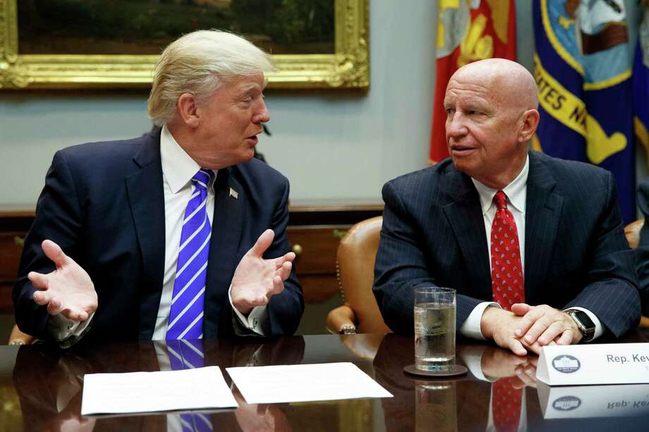 Rep. Kevin Brady, R-Texas, right, listens as President Donald Trump speaks recently. Brady says he has discussed the 401(k) issue with Trump. Photo: Evan Vucci, STF / Copyright 2017 The Associated Press. All rights reserved.