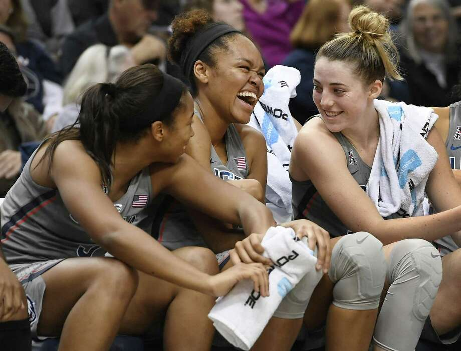 Connecticut's Megan Walker, left, Azura Stevens, center, and Katie Lou Samuelson, right, share a light moment on the bench during the second half an NCAA women's college exhibition basketball game against Fort Hays State, Wednesday, Nov. 1, 2017, in Hartford, Conn. (AP Photo/Jessica Hill) Photo: Jessica Hill / Associated Press / AP2017
