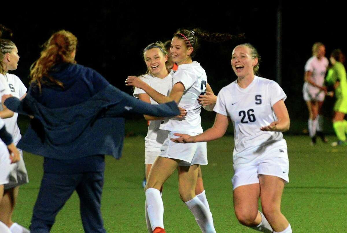 Staples celebrates its win over Ridgefield in an FCIAC semifinal in Wilton on Wednesday.
