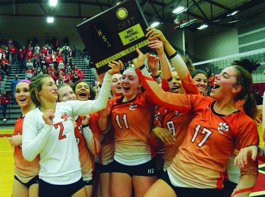 The Edwardsville girls' volleyball team celebrates after wining the Class 4A Chatham Glenwood Sectional championship after defeating Pekin in the final on Wednesday in Chatham.