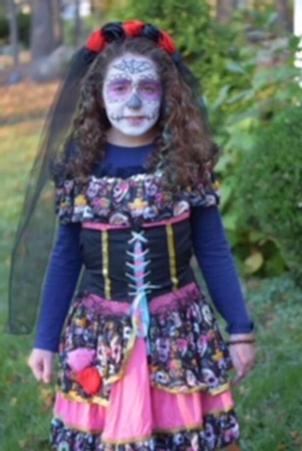 Sylvia Pinheiro, 11, of Brookfield dresses up for Halloween. She even did the makeup herself! Photo: Contributed/ Heidi Pinheiro