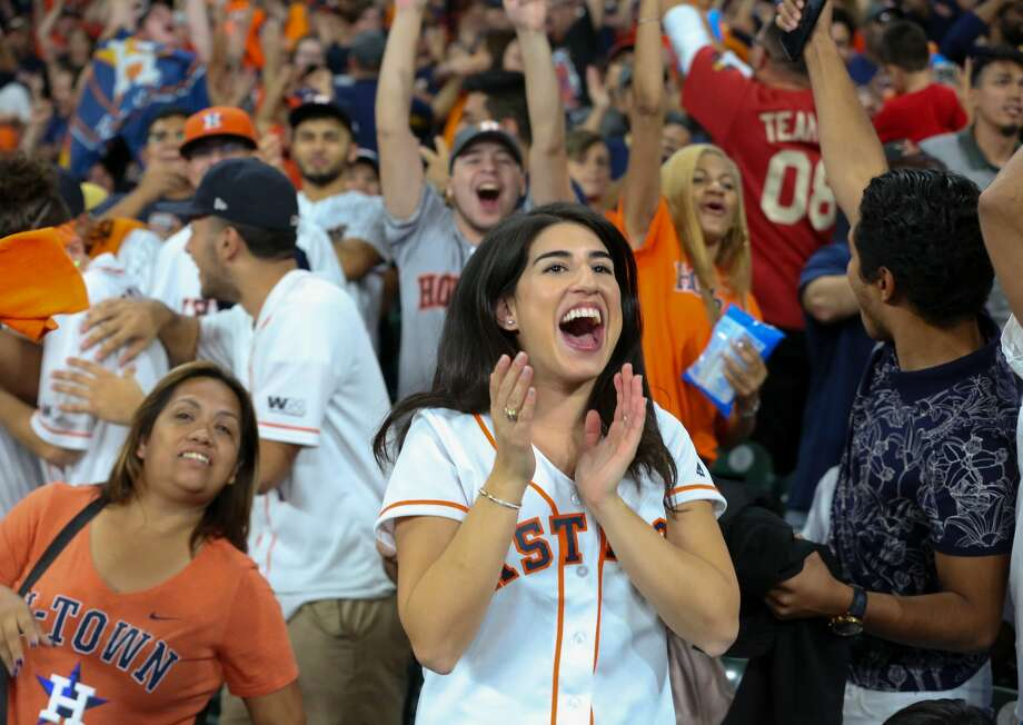 Houston Astros fans celebrating the team scoring two runs during the top first inning at the Minute Maid Park World Series Game 7 fan watch party on Wednesday, Nov. 1, 2017 in Houston. Photo: Yi-Chin Lee/Houston Chronicle