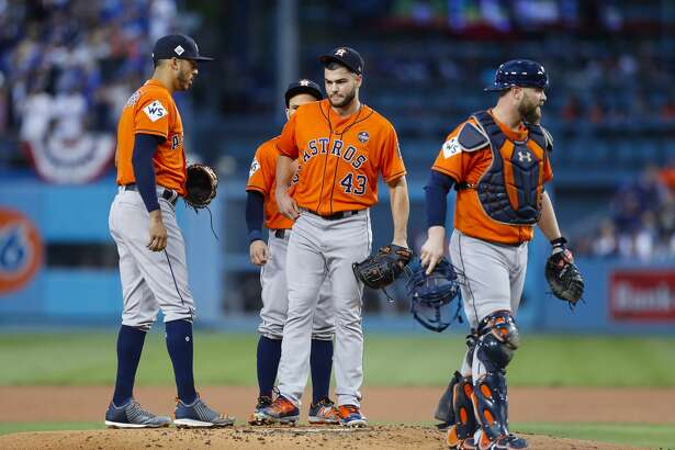 Houston Astros catcher Brian McCann (16), starting pitcher Lance McCullers Jr. (43), shortstop Carlos Correa and second baseman Jose Altuve meet on the mound after McCullers Jr. hit Los Angeles Dodgers third baseman Justin Turner (10) during the first inning of Game 7 of the World Series at Dodger Stadium on Wednesday, Nov. 1, 2017, in Los Angeles.