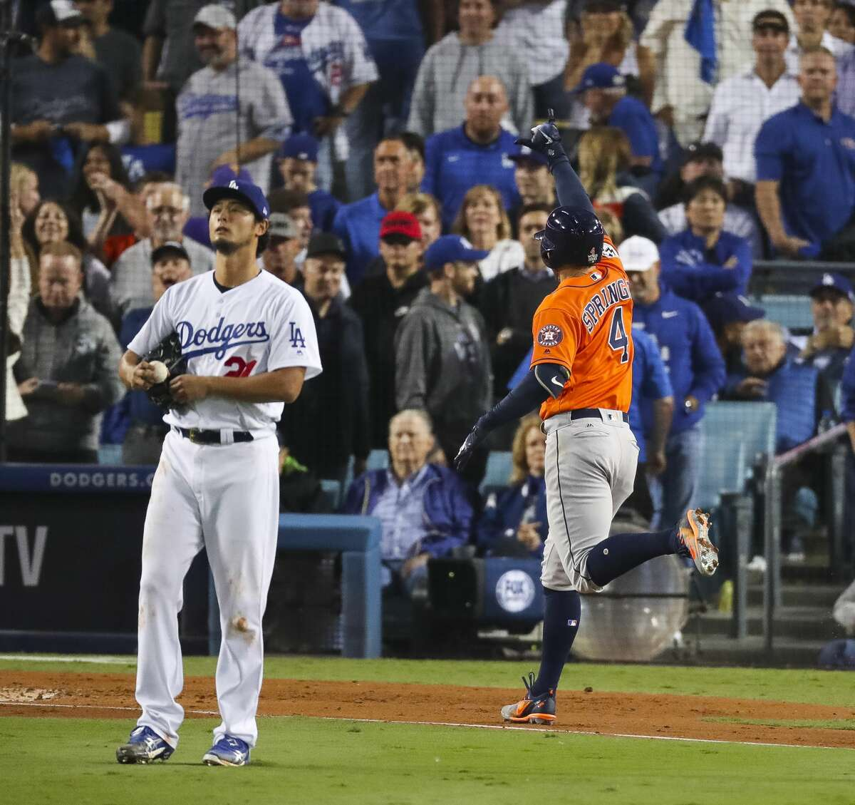 Los Angeles Dodgers starting pitcher Yu Darvish (21) reacts as Houston Astros center fielder George Springer (4) runs home after hitting a two-run home run during the second inning of Game 7 of the World Series at Dodger Stadium on Wednesday, Nov. 1, 2017, in Los Angeles.