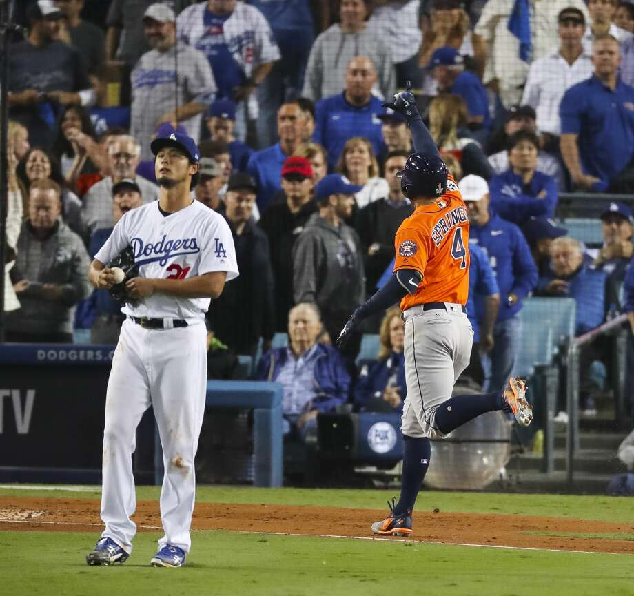 Los Angeles Dodgers starting pitcher Yu Darvish (21) reacts as Houston Astros center fielder George Springer (4) runs home after hitting a two-run home run during the second inning of Game 7 of the World Series at Dodger Stadium on Wednesday, Nov. 1, 2017, in Los Angeles. Photo: Michael Ciaglo/Houston Chronicle