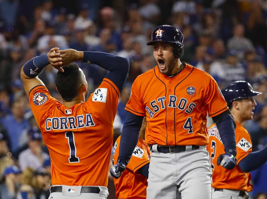 Houston Astros shortstop Carlos Correa (1) greets George Springer after Springer hit a two-run home run in the second inning of Game 7 of the World Series at Dodger Stadium on Wednesday, Nov. 1, 2017, in Los Angeles. Photo: Karen Warren/Houston Chronicle