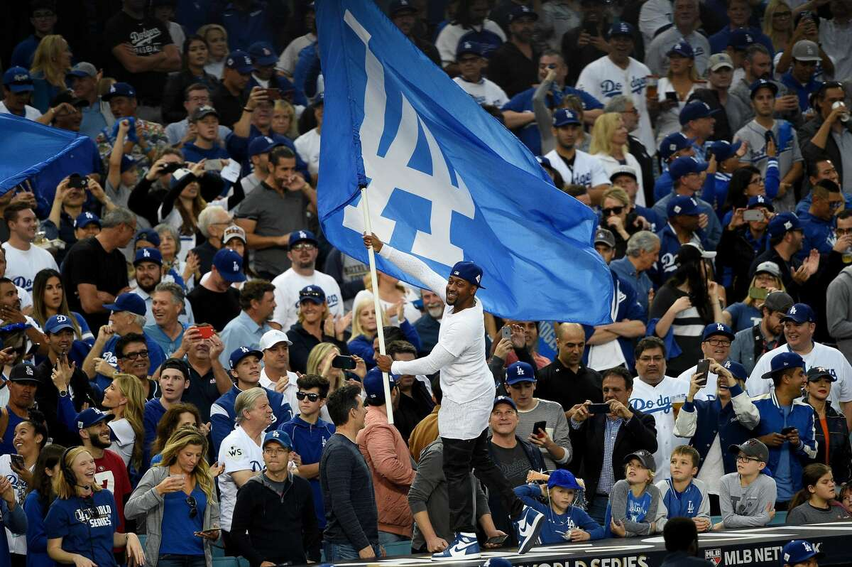 Actor Jaleel White waves the Los Angeles Dodgers flag prior to game seven of the 2017 World Series between the Houston Astros and the Los Angeles Dodgers at Dodger Stadium on November 1, 2017 in Los Angeles, California. (Photo by Kevork Djansezian/Getty Images)