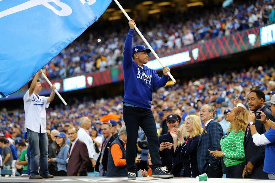 Actors Rob Lowe and Ken Jeong wave Dodger flags on top prior to Game 7 of the 2017 World Series between the Houston Astros and the Los Angeles Dodgers at Dodger Stadium on Wednesday, November 1, 2017 in Los Angeles, California. (Photo by Alex TrautwigMLB Photos via Getty Images) Photo: Alex Trautwig/MLB Photos Via Getty Images