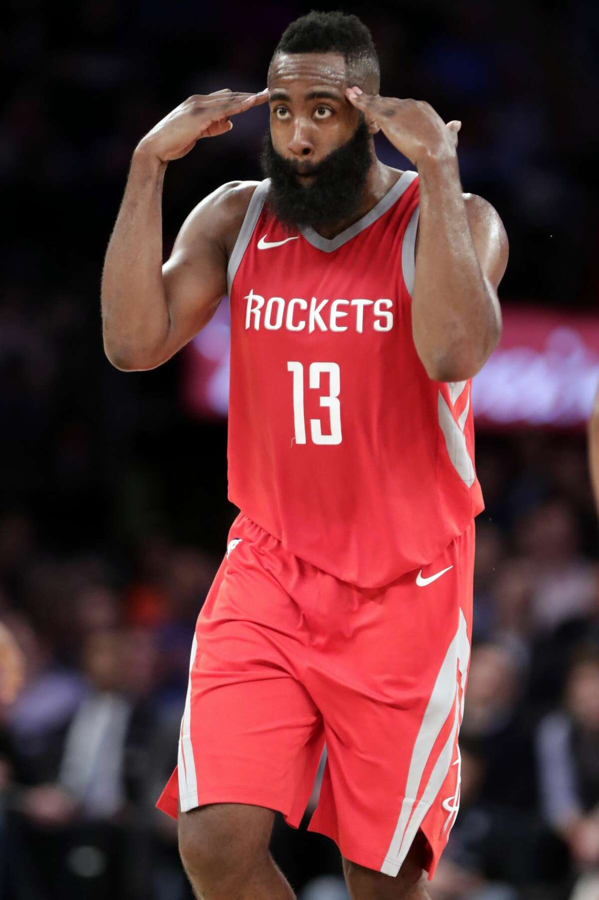 Houston Rockets' James Harden (13) celebrates after making a three point basket during the second half of an NBA basketball game against the New York Knicks Wednesday, Nov. 1, 2017, in New York. The Rockets won 119-97. (AP Photo/Frank Franklin II)