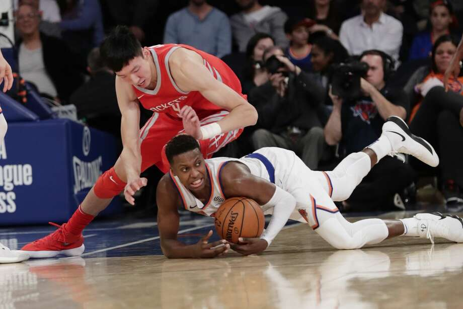Houston Rockets' Zhou Qi, of China, fights for the ball with New York Knicks' Frank Ntilikina, below, during the second half of an NBA basketball game Wednesday, Nov. 1, 2017, in New York. The Rockets won 119-97. (AP Photo/Frank Franklin II) Photo: Frank Franklin II/Associated Press