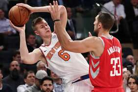 Houston Rockets' Ryan Anderson (33) defends New York Knicks' Kristaps Porzingis (6) during the second half of an NBA basketball game Wednesday, Nov. 1, 2017, in New York. The Rockets won 119-97. (AP Photo/Frank Franklin II)