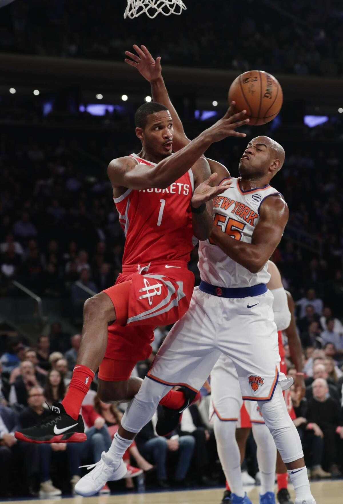 Houston Rockets' Trevor Ariza (1) passes away from New York Knicks' Jarrett Jack (55) during the first half of an NBA basketball game Wednesday, Nov. 1, 2017, in New York. (AP Photo/Frank Franklin II)