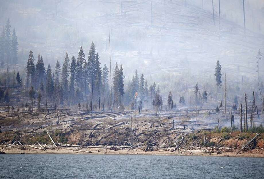 The Berry Fire burns off the shore of Jackson Lake in Grand Teton National Park in Wyoming. Photo: Brennan Linsley / Brennan Linsley / Associated Press 2016 / Copyright 2016 The Associated Press. All rights reserved. This material may not be published, broadcast, rewritten or redistribu