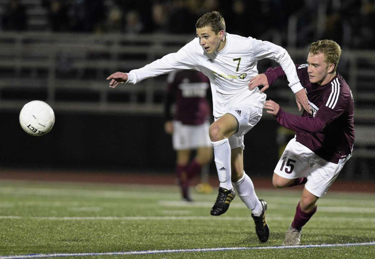 Barlow's Anthony Paolini (7) and Bethel's James Tuohy (15) fight for the ball in the SWC boys soccer semi final game between Bethel and Joel Barlow high schools, Wednesday night, November 1, 2017, at Joel Barlow High School, in Redding, Conn.