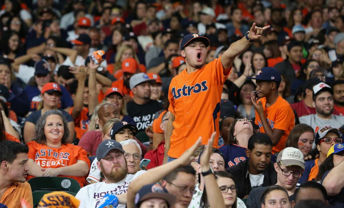 Houston Astros fans cheer for their team against Los Angeles Dodgers while watching World Series Game 7 from Minute Maid Park on Wednesday, Nov. 1, 2017, in Houston.