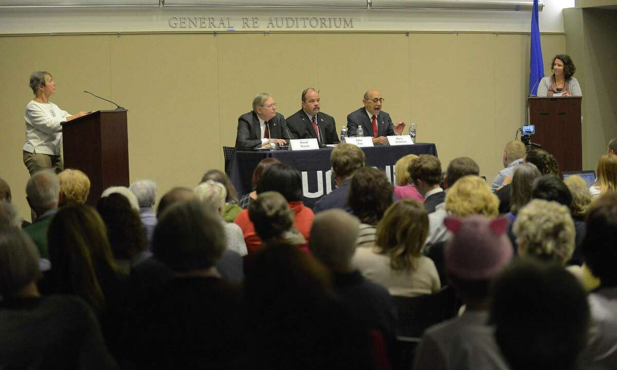 Mayoral candidates, from left, Democratic incumbent Mayor David Martin, unaffiliated challenger John Zito and Republican challenger Barry Michelson answer questions from The League of Women Voters of Stamford, the Stamford Advocate and UCONN Stamford during a public debate at UConn's GenRe Auditorium in Stamford, Connecticut on Wednesday, Nov. 1, 2017. The LWV's Jara Burnett and Stamford Advocate Managing Editor Stephanie Borise moderate the event attended several residents.