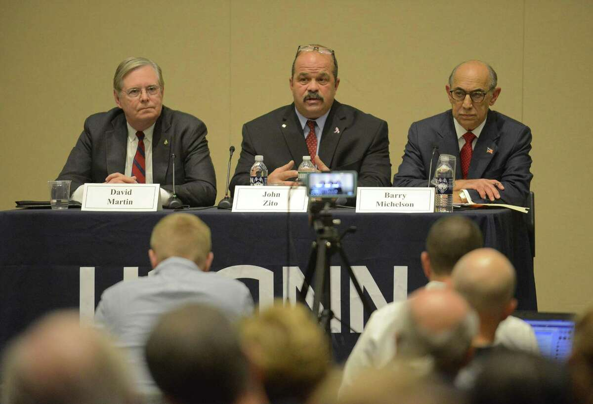 Mayoral candidates, from left, Democratic incumbent Mayor David Martin, unaffiliated challenger John Zito and Republican challenger Barry Michelson answer questions during the League of Women Votes debate at UConn's GenRe Auditorium in Stamfordon Wednesday..