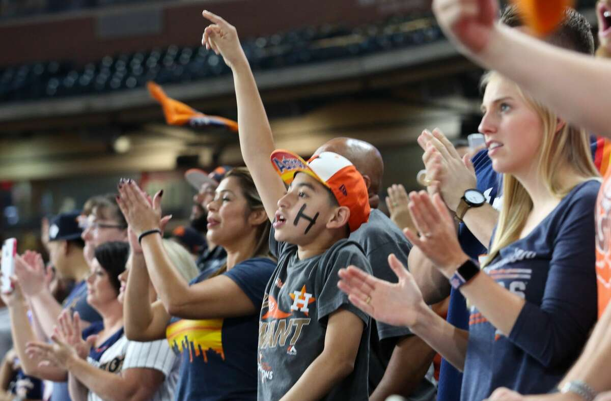 Houston Astros fans cheer during the World Series Game 7 fan watch party at Minute Maid Park on Wednesday, Nov. 1, 2017, in Houston.