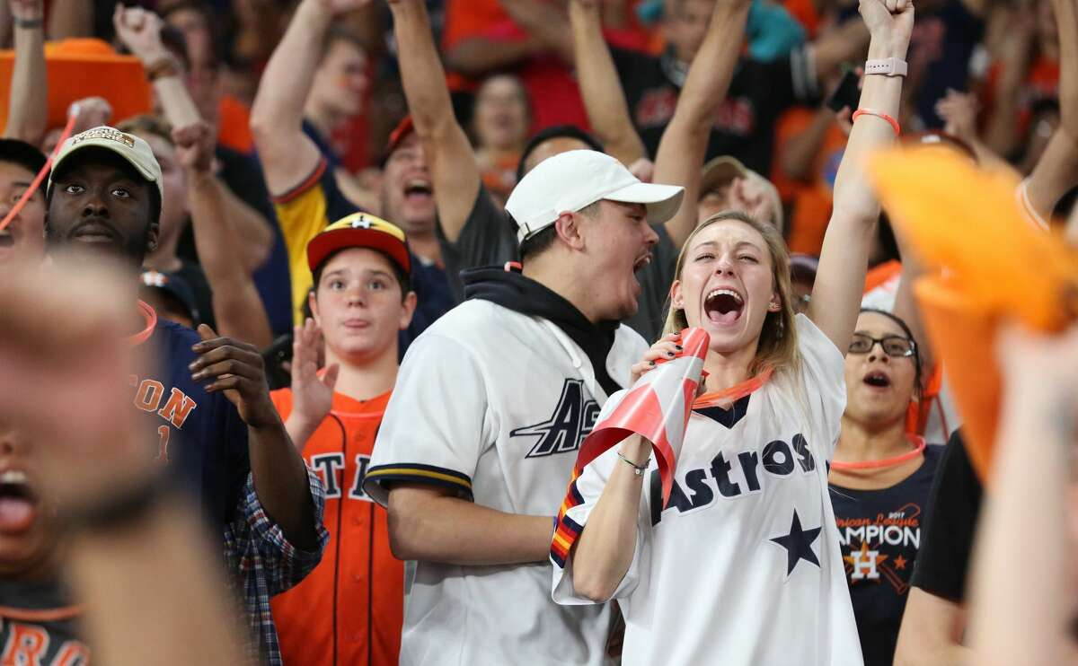 Houston Astros fans react Hose Altuve stealing onto the second base against Los Angeles Dodgers at World Series Game 7 from Minute Maid Park on Wednesday, Nov. 1, 2017, in Houston.
