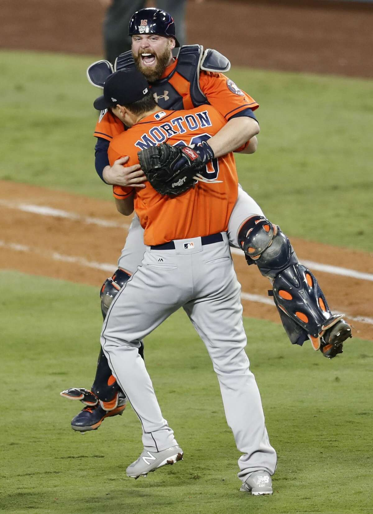 Houston Astros catcher Brian McCann (16) and pitcher Charlie Morton (50) celebrate the Houston Astros win over the Los Angeles Dodgers 5-1 in Game 7 of the World Series at Dodger Stadium on Wednesday, Nov. 1, 2017, in Los Angeles. The Astros took the Series 4-games-to-3 to capture the franchise's first title.