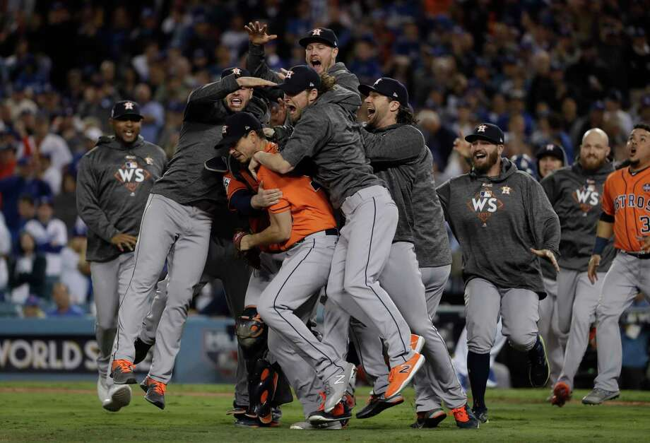 The Houston Astros celebrate after Game 7 of baseball's World Series against the Los Angeles Dodgers Wednesday, Nov. 1, 2017, in Los Angeles. The Astros won 5-1 to win the series 4-3. (AP Photo/Matt Slocum) Photo: Matt Slocum, STF / Copyright 2017 The Associated Press. All rights reserved.