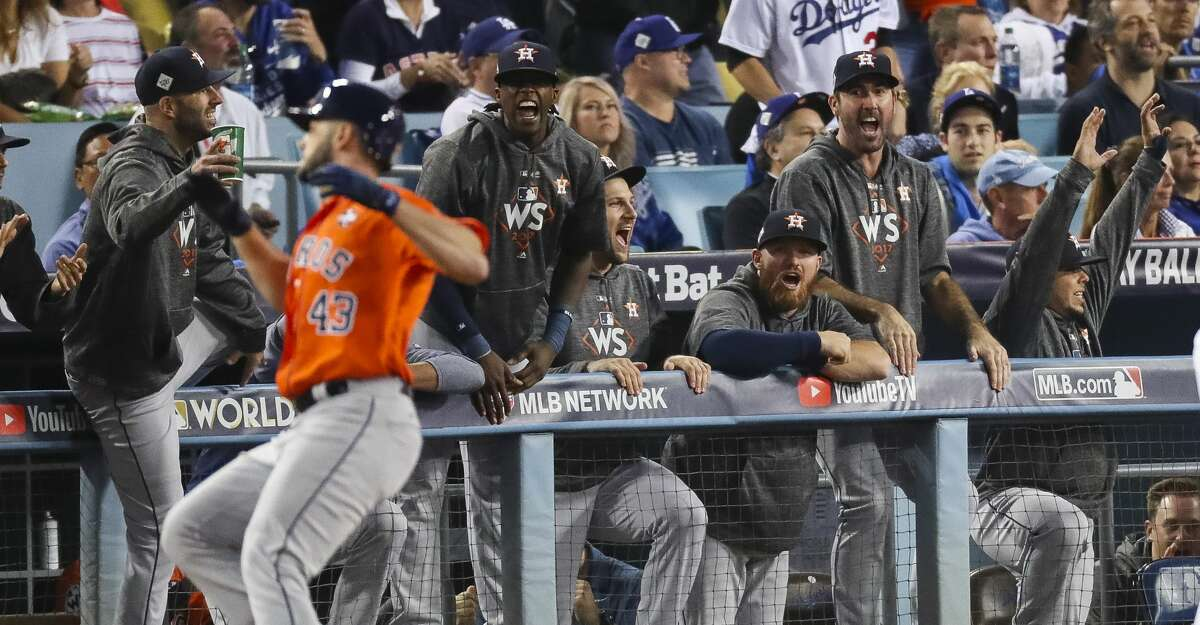 The Astros dugout celebrates starting pitcher Lance McCullers Jr.'s (43) RBI ground out that allows Brian McCann to score during the second inning of Game 7 of the World Series at Dodger Stadium on Wednesday, Nov. 1, 2017, in Los Angeles. ( Michael Ciaglo / Houston Chronicle )