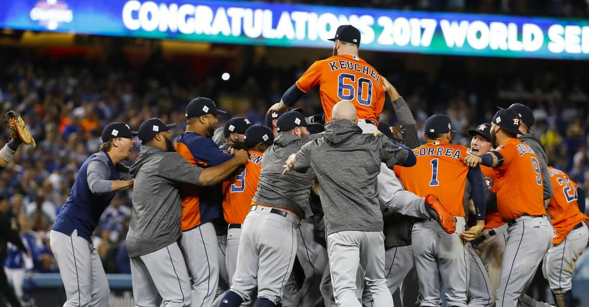 The Astros celebrate their 5-1 win over the Dodgers in Game 7 of the World Series at Dodger Stadium on Wednesday, Nov. 1, 2017, in Los Angeles. ( Karen Warren / Houston Chronicle )
