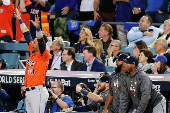 Houston Astros first baseman Yuli Gurriel (10) leaps in the air to celebrate a two-run home run by Astros center fielder George Springer off Los Angeles Dodgers starting pitcher Yu Darvish during the second inning of Game 7 of the World Series at Dodger Stadium on Wednesday, Nov. 1, 2017, in Los Angeles. ( Brett Coomer / Houston Chronicle )