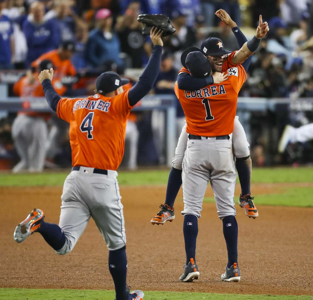 Houston Astros center fielder George Springer (4), second baseman Jose Altuve (27) and shortstop Carlos Correa (1) celebrate as the Astros beat the Dodgers 5-1 in Game 7 of the World Series at Dodger Stadium on Wednesday, Nov. 1, 2017, in Los Angeles.