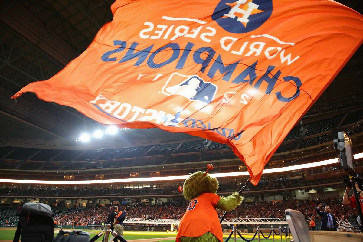 Houston Astros mascot Orbit waves the World Series Championship to celebrate the team?'s first World Series Championship from Minute Maid Park on Wednesday, Nov. 1, 2017, in Houston.