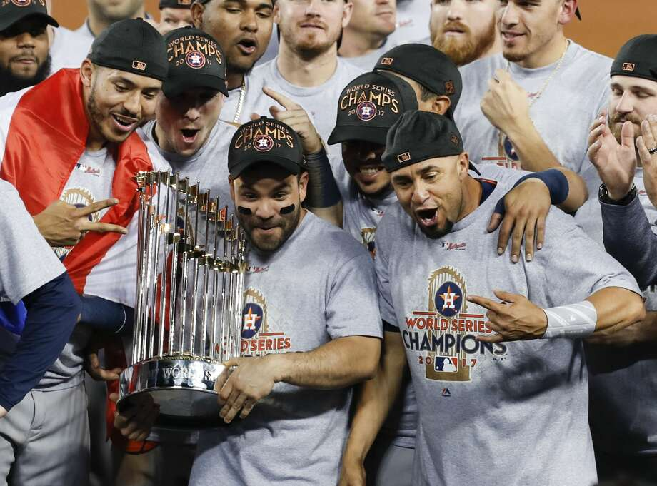 Houston Astros second baseman Jose Altuve (27) holds the  the World Series trophy as the Astros celebrate beating the Los Angeles Dodgers 5-1 in Game 7 of the World Series at Dodger Stadium on Wednesday, Nov. 1, 2017, in Los Angeles. The Astros took the Series 4-games-to-3 to capture the franchise's first title. Photo: Brett Coomer/Houston Chronicle