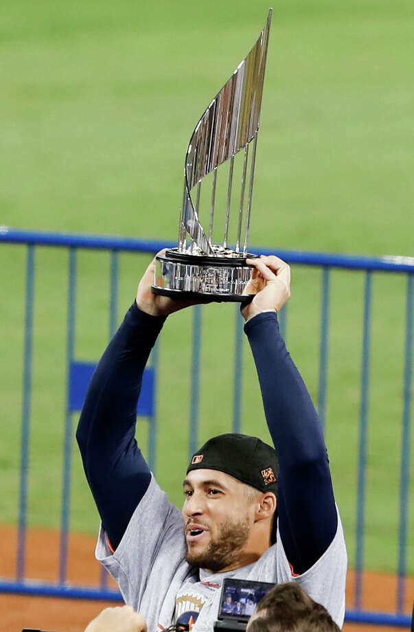 Houston Astros center fielder George Springer holds up the MVP trophy after the Astros beat the Los Angeles Dodgers 5-1 in Game 7 of the World Series at Dodger Stadium on Wednesday, Nov. 1, 2017, in Los Angeles. The Astros took the Series 4-games-to-3 to capture the franchise's first title. ( Brett Coomer / Houston Chronicle ) Photo: Brett Coomer/Houston Chronicle