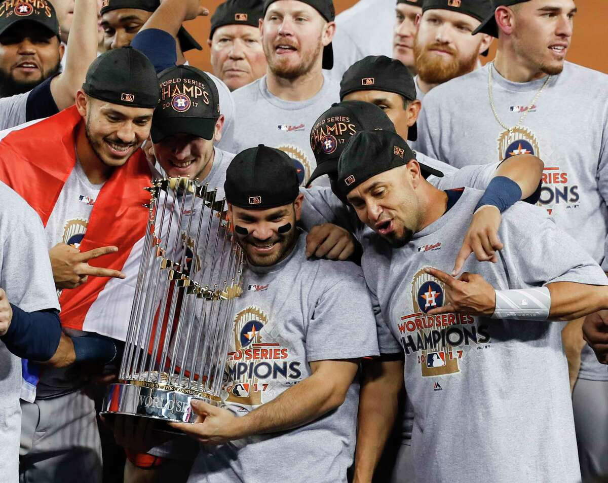 Second baseman Jose Altuve holds The Commissioner's Trophy as the Astros celebrate winning the World Series at Dodger Stadium on Wednesday night.