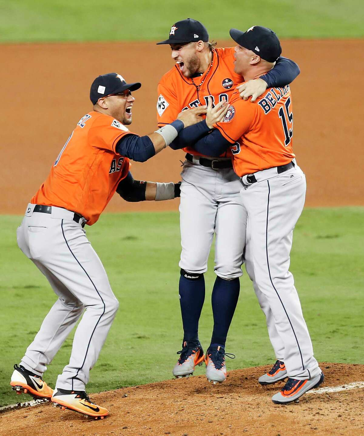 Carlos Beltran, right, celebrates with teammates after the Astros beat the Los Angeles Dodgers 5-1 in Game 7 of the World Series at Dodger Stadium on Wednesday night. For Beltran, a 20-year major league veteran, it was his first World Series victory.