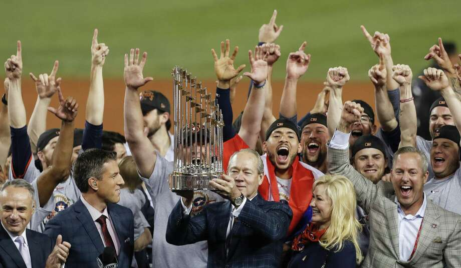 The Houston Astros hoist the World Series trophy as they celebrate beating the Los Angeles Dodgers 5-1 in Game 7 of the World Series at Dodger Stadium on Wednesday, Nov. 1, 2017, in Los Angeles. The Astros took the Series 4-games-to-3 to capture the franchise's first title. ( Brett Coomer / Houston Chronicle ) Photo: Brett Coomer / Houston Chronicle / © 2017 Houston Chronicle