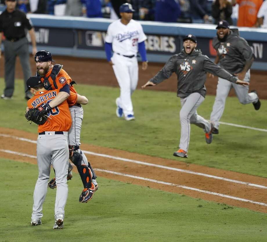 Astros catcher Brian McCann (16) and pitcher Charlie Morton (50) celebrate the Houston Astros win over the Los Angeles Dodgers 5-1 in Game 7 of the World Series at Dodger Stadium on Wednesday, Nov. 1, 2017, in Los Angeles. The Astros took the Series 4-games-to-3 to capture the franchise's first title. ( Brett Coomer / Houston Chronicle ) Photo: Brett Coomer / Houston Chronicle / © 2017 Houston Chronicle